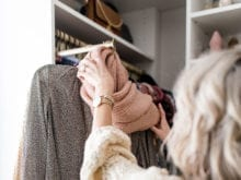 Pull out scarf rack in fashion blogger Brittany Sjogren's walk in closet by California Closets