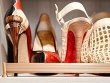 Slanted shoe shelves in the custom closet of California Closets client Cindy Brunson