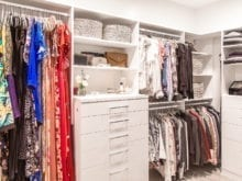Hanging racks, shelving, and drawers in blogger Lindsay Surowitz's custom walk in closet