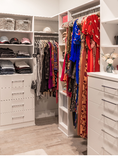 Hanging space, shelves and drawers in blogger Lindsay Surowitz's custom walk in closet