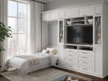 Grey apartment media room with California Closets' white wall bed