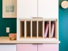 White California Closets shelving with wooden inserts for binders