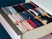 Pink dresser drawer with neatly organized clothing