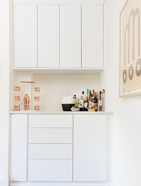 White shelving for wine bar utensils