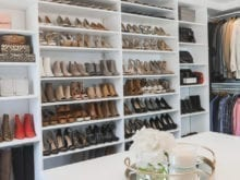 Kristen Lawler's custom walk-in closet with white shelving for shoes